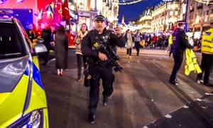 Armed police officer at Oxford Circus