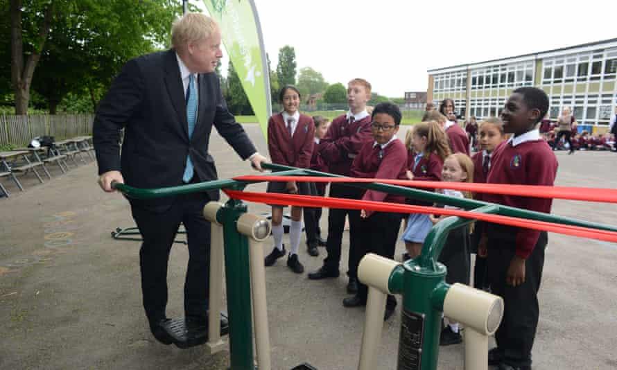 Boris Johnson unveils new sports equipment at a primary school in Uxbridge
