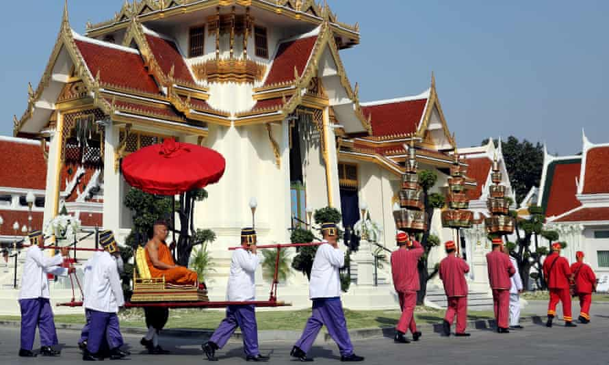 A monk attends a procession with royal soldiers at the Debsirindrawas temple.