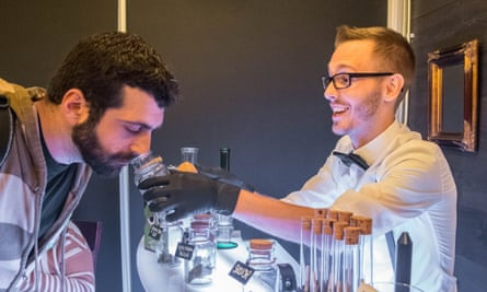 Andrew Mieure of Top Shelf Budtending helps a customer make his choice.