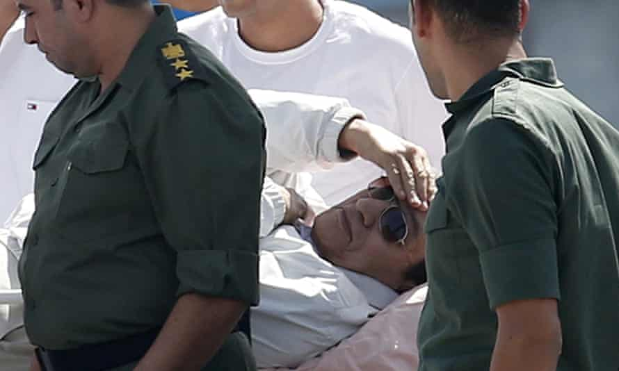 Mubarak is returned to hospital after a court hearing in 2013.