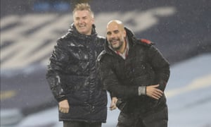 Aston Villa's Dean Smith, left, and Manchester City's Pep Guardiola are enjoying themselves despite being drookit.