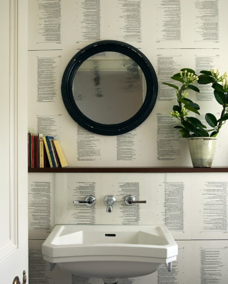Pages from a secondhand novel have been pasted on a bathroo wall