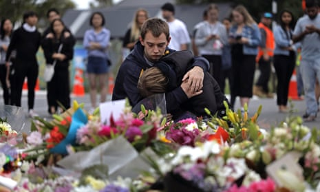 Mourners pay their respects at a makeshift memorial near Al Noor mosque in Christchurch