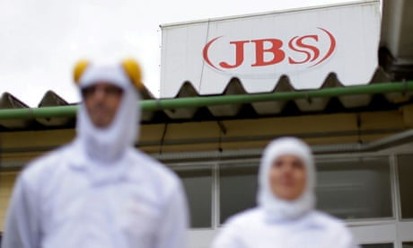 Workers at Brazil's JBS, the world's largest meat-processing firm, in Lapa, Paraná state.