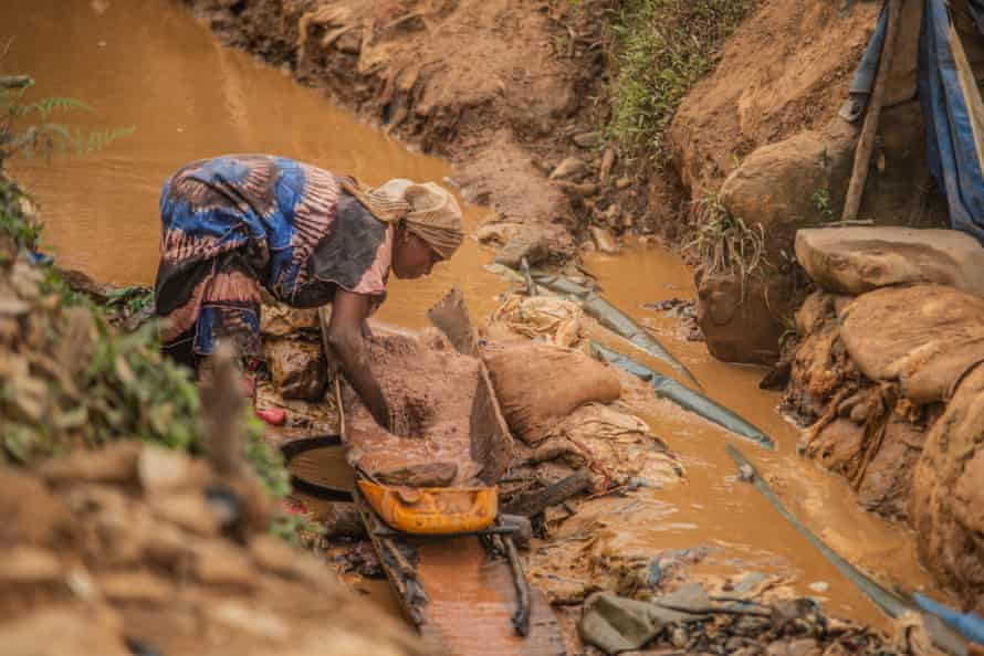 A woman pans for gold in Kamituga in DRC's South Kivu Province in March.