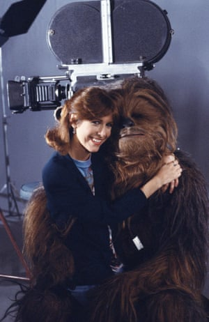 Carrie Fisher with Peter Mayhew on the set of 'Classic Creatures: Return of the Jedi, a documentary about the second film in the Star Wars saga in 1983