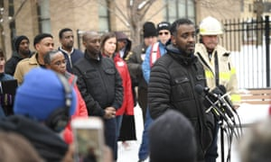 The Minneapolis city councilman Abdi Warsame addresses the media outside the building.