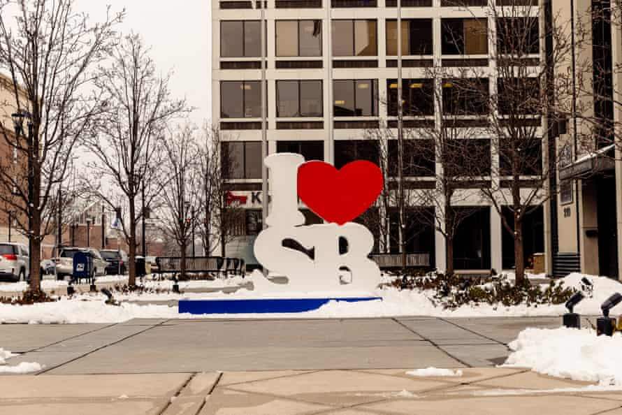 A city pride sculpture on Michigan Street, a busy row of shops and office buildings in downtown South Bend, Indiana.