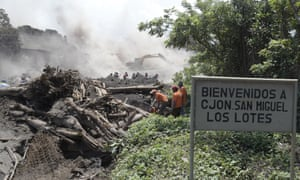 Rescuers search for survivors in remains in the village of San Miguel Los Lotes on 6 June.