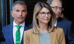 Lori Loughlin and Mossimo Giannulli leave the federal courthouse in Boston, Massachusetts, on 3 April.