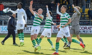 Celtic players celebrate at the Kilmac Stadium after finally breaking down Dundee