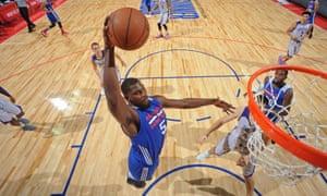 alex poythress of philadelphia 76ers dunks a basketball
