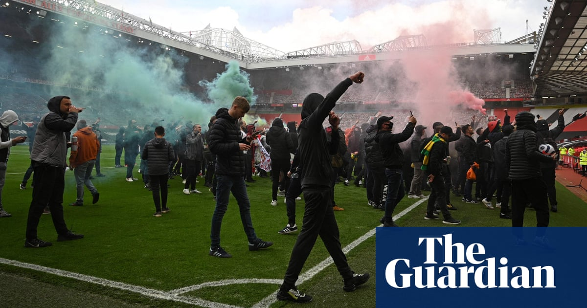 Protesting Manchester United fans invade Old Trafford – in pictures