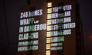 A message warning of dangerous cladding projected on to the NV buildings in Salford