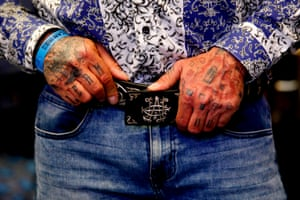 """Guadalajara, Mexico. A models poses wearing a belt by """"El Chapo 701,"""" a fashion line bearing the nickname of the jailed Mexican drug lord Joaquín Guzmán Loera,who is serving a life sentence, during the IM Intermoda Mexico fashion fair"""