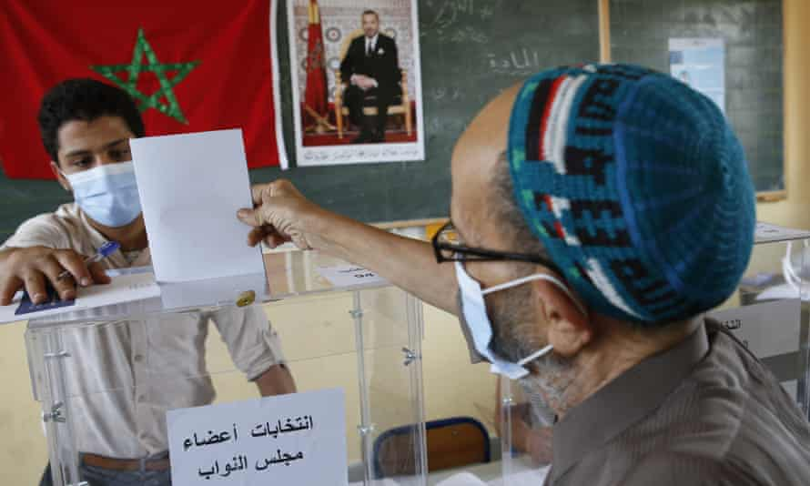 A man casts his ballot inside a polling station in Casablanca, Morocco