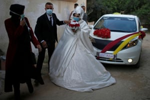 Gaza Strip A couple maintain coronavirus precautions on their wedding day in the northern Gaza Strip