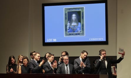 Bidding representatives react after Leonardo da Vinci's Salvator Mundi is sold for $450 million a Christie's in New York on 15 November.