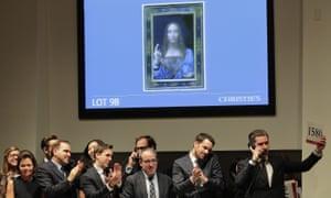 Bidding representatives react after Leonardo da Vinci's Salvator Mundi sold for $400 million at Christie's ($450.3m, including auction house premium)