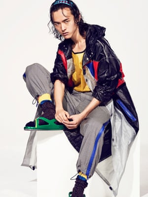 Model wears top £255, coat £1,050, trousers £515, headband £70, socks £130, and sandals £240, all prada.com