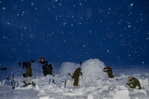 Canadian soldiers on the Arctic Operations Advisors course build igloos under the supervision of Inuit instructors at the Crystal City training facility near Resolute Bay, Nunavut.