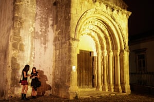 Leiria, Portugal Visitors to the Entremuralhas goth music festival check for directions at Leiria Castle