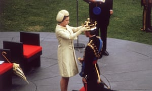Tudor motif … Queen Elizabeth II crowns Prince Charles at his investiture at Caernarfon castle, 1969.