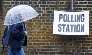 A man arrives at a polling station in London.