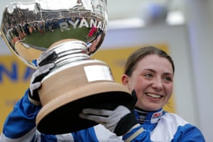 A beaming Bryony Frost shows off the Ryanair Chase trophy