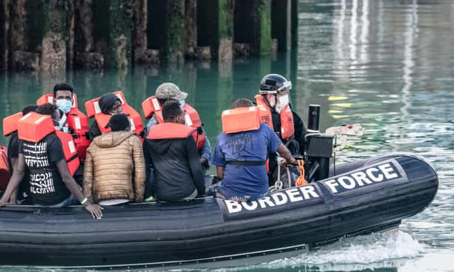 A Border Force dinghy escorts intercepted migrants into Dover.