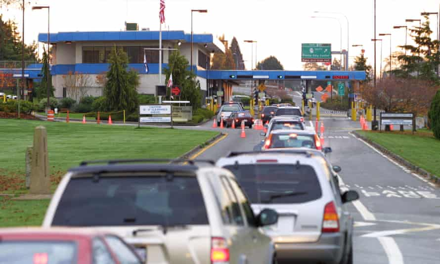 Vehicles line up to enter the US at the border crossing between Blaine, Washington, and White Rock, British Columbia, but along the beach where Cedella Roman was arrested the border is unmarked.