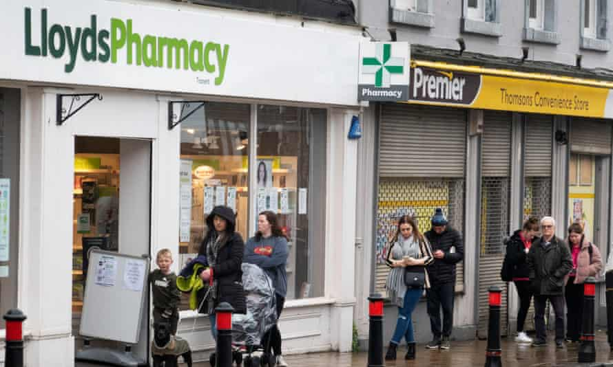 People queue outside Lloyds Pharmacy in Tranent,
