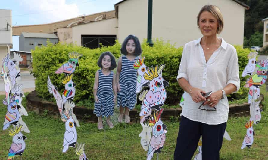 Senator Kristina Keneally at the roundabaout on Christmas Island with cutouts of Kopika and Tharunicaa.
