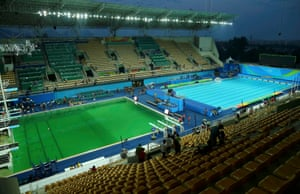 A general view of the Olympic diving pool (left) and the pool for the waterpolo and synchronized swimming (right) this afternoon – the diving pool having turned a curious shade of green.