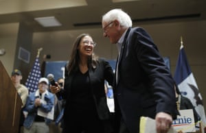 Democratic presidential candidate Sen. Bernie Sanders, I-Vt., right, laughs with Rep. Alexandria Ocasio-Cortez, D-NY, at a campaign event Sunday, Jan. 26, 2020, in Storm Lake, Iowa. (AP Photo/John Locher)