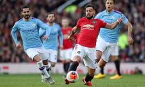 Manchester United's Bruno Fernandes (right) stretches to reach the ball ahead of Ilkay Gündogan of Manchester City during the game at Old Trafford on Sunday.