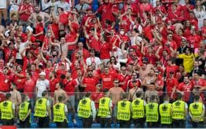 Switzerland fans cheer on their team.