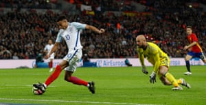 Jesse Lingard goes round Pepe Reina but can only cut the ball back to Spain's Nacho.