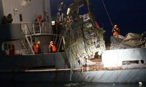 Emergency workers recover wreckage from the Tupolev TU-154 plane from the Black Sea.