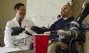 Professor Charles Y Liu and his patient Erik Sorto, who can now control a robot arm by the power of thought, after having microelectrodes implanted in his brain.