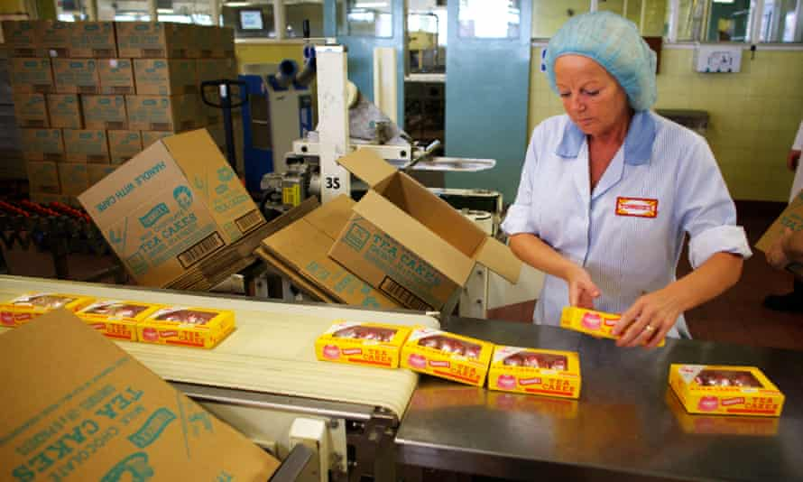 A worker on a Tunnock's production line.