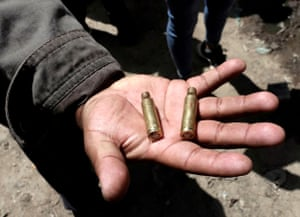 A man shows cartridge cases after clashes in El Alto on the outskirts of La Paz.