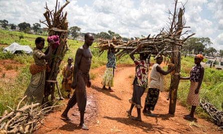 Burundian refugees return from an hours-long trip outside the Nyarugusu refugee camp to collect firewood.