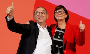 Norbert Walter-Borjans and Saskia Esken gesture after winning the vote for the leadership of the SPD