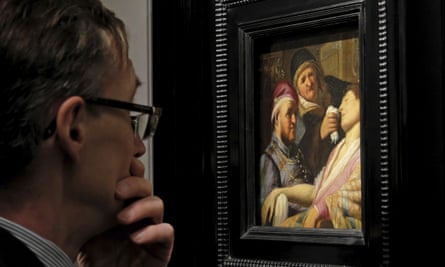 A visitor to the TEFAF art fair looks at a newly discovered painting by Dutch master Rembrandt