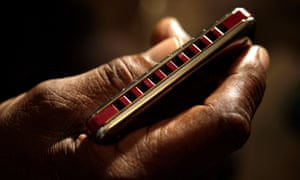 Big George Brock holding his harmonica