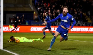 Scott Wagstaff wheels away in delight after scoring his second and AFC Wimbledon's third against West Ham.