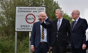 Michel Barnier (centre) accompanied by the Irish foreign affairs minister, Charles Flanagan (right), at the border separating Northern Ireland and the Irish Republic.