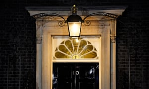 A light shines above the door of No 10 during yesterday's cabinet meeting.